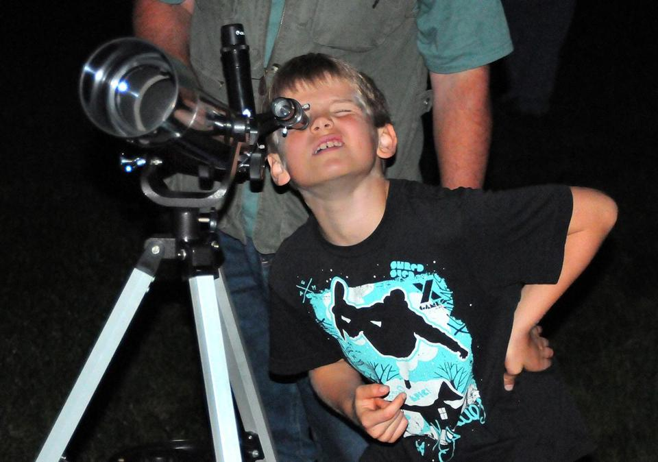 Ryan Johnson-Rees, a Scituate 8-year-old, pondered the heavens at an event this fall held by the South Shore Astronomical Society.